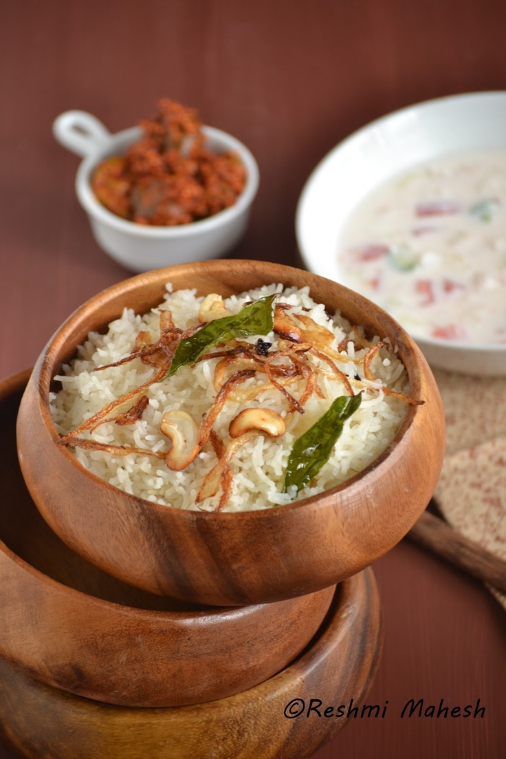 ghee rice, an indian rice made with clarified butter, spices, fried onions and nuts