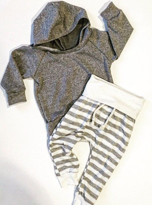 Cute gray hoodie. Made out of French terry! With really cute skinny sweats Sizing newborn to 24 months All clothing made in a pet/smoke free: