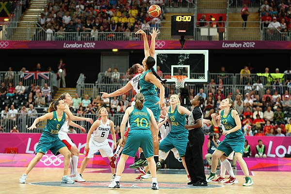 High point - Canada's Krista Phillips & Australia's Liz Cambage in the Women's Basketball match