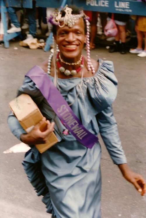 """Marsha P Johnson was atransgenderrights activist,Queen of Stonewall and Transgender Revolutionary.  She was a co-founder,Street Transvestite Action Revolutionaries(S.T.A.R.) in the early 1970s and became the """"mother"""" of S.T.A.R. House along with Sylvia Rivera, getting together food and clothing to help support the young trans women living in the house on thelower East Sideof New York."""