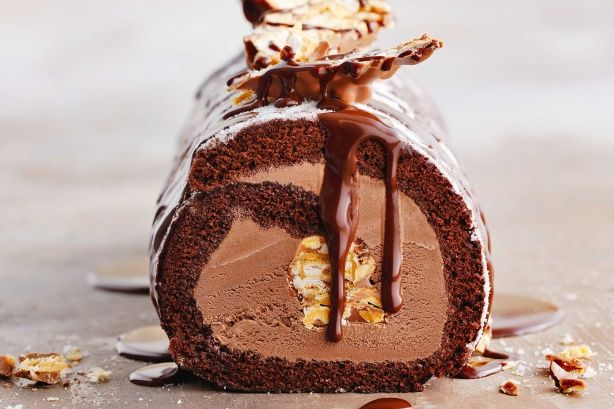 Enjoy the surprise with a hidden chocolate bar nestled inside this frozen ice-cream and cake dessert.