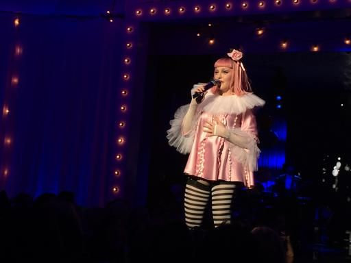 MIAMI BEACH, Fla. (AP) — Madonna kissed Ariana Grande, repeatedly criticized President elect Donald Trump and said she was ashamed to be an American in a magnetic performance in Miami on Friday night where she raised more than $7.5 million for ...