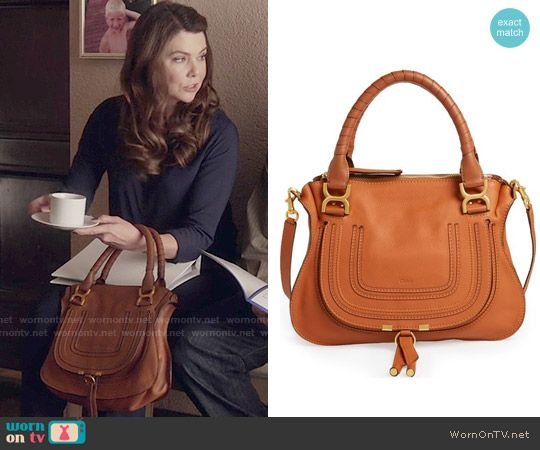 Lorelai's tan handbag on Gilmore Girls: A Year in the Life.  Outfit Details: https://wornontv.net/62615/ #GilmoreGirls