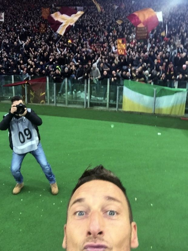 Roma's Francesco Totti just squeezes into the frame of his selfie after scoring against Lazio