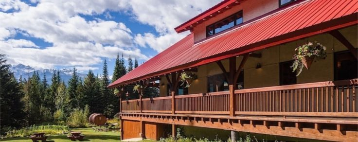 Our beautiful lodge has hanging flower baskets, a merry red roof and expansive wrap-around decks.