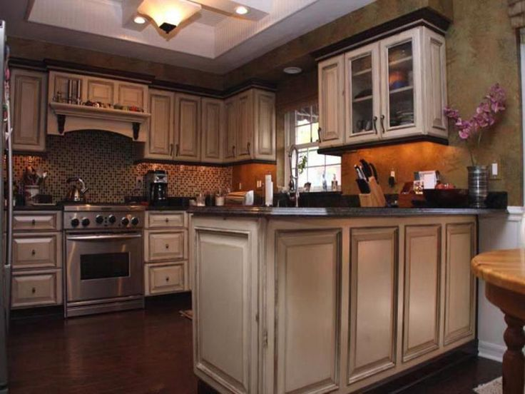 Best + Painting oak cabinets white ideas on Pinterest  Painted