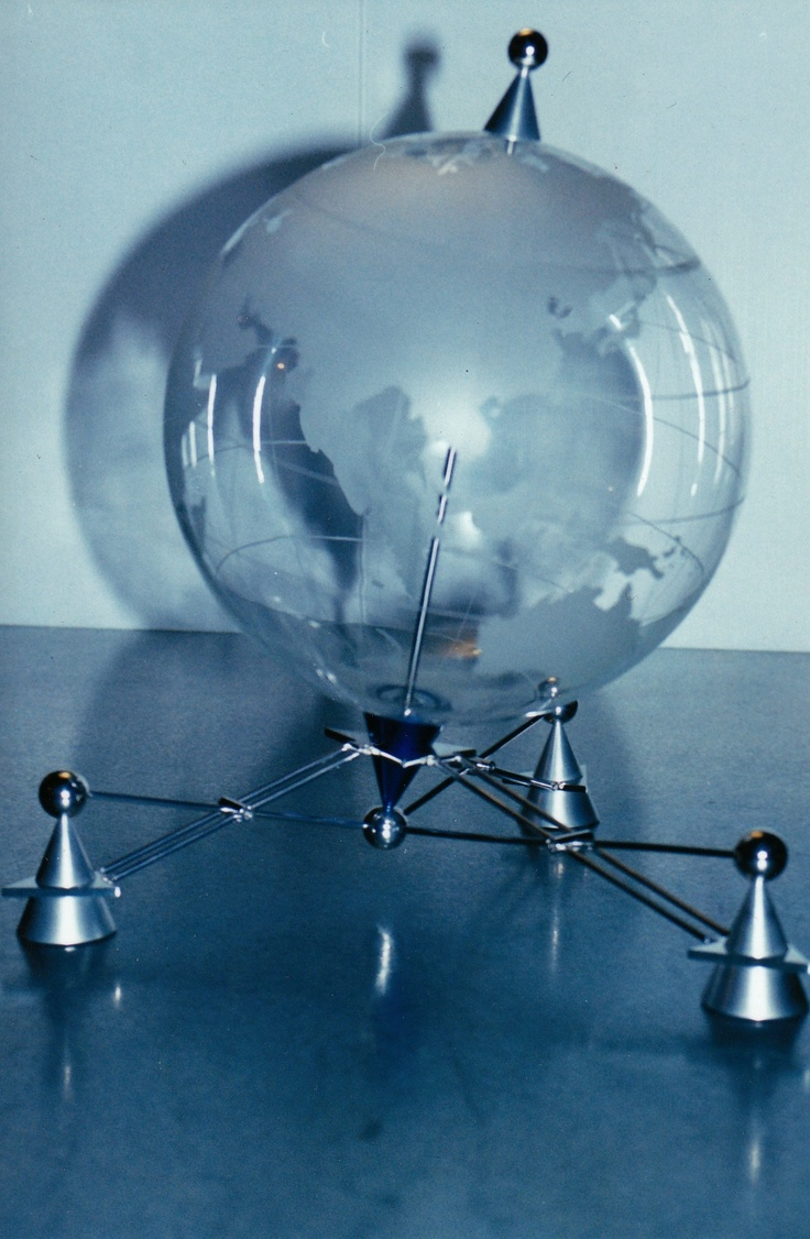 Limited production corporate globes. Fabricated  stainless steel, silver plated brass, anodized aluminium, hand blown and etched glass.