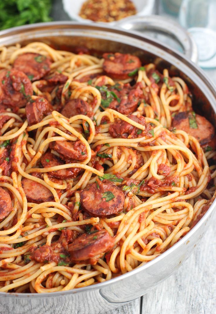 Smoked sausage fra diavolo is a pasta dish with a homemade spicy tomato sauce. This favorite is served with spaghetti, smoked sausage, and fresh herbs.