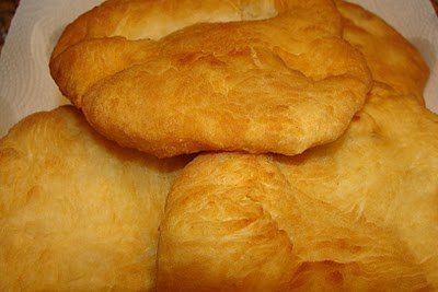 Jamaican bake | Cut a pocket on the side of the bake and add saltfish mixture. Enjoy!