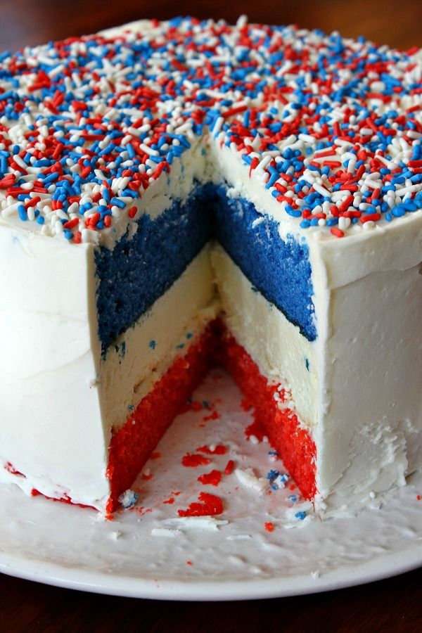 Red, White and Blue Cheesecake Cake. A layer of cheesecake sandwiched between two layers of vanilla cake. Best of both worlds : )
