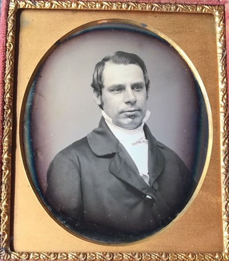 This is a daguerreotype of a handsome young man with wonderfully styled hair and a small chin beard. The man is looking away from the camera with a pondering look on his face. He is wearing a nice suit and has his collar popped.   eBay!