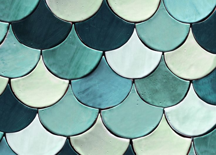 Handmade fan shaped ceramic tiles in various shades of green and turquoise