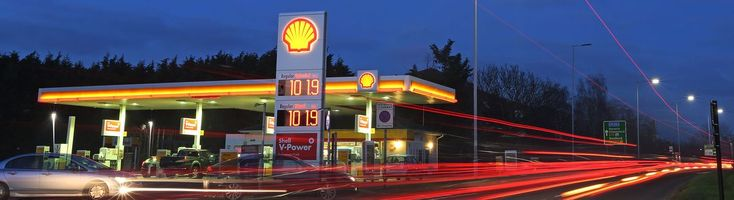 Royal Dutch Shell Plc opened its first rapid charging point for electric cars at gasoline stations in the U.K., the latest sign that oil majors are waking up to the disruption plug-in vehicles could have on their industry.