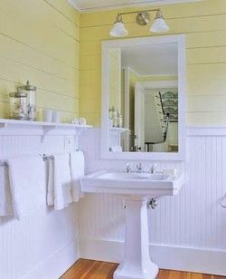Pedestal sink; shelf over wainscoting. {The guest bath does not need a lot of storage but *does* need a place to set a hair dryer and makeup.}