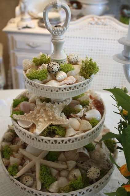 Get creative with your everyday items. Seashells and moss transform this tiered pastry stand. Can you see this as a centerpiece at a beach house celebration?
