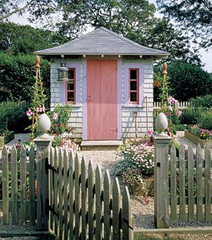 solien of falmouth massachusetts incorporated this shingled garden shed into a fenced vegetable garden
