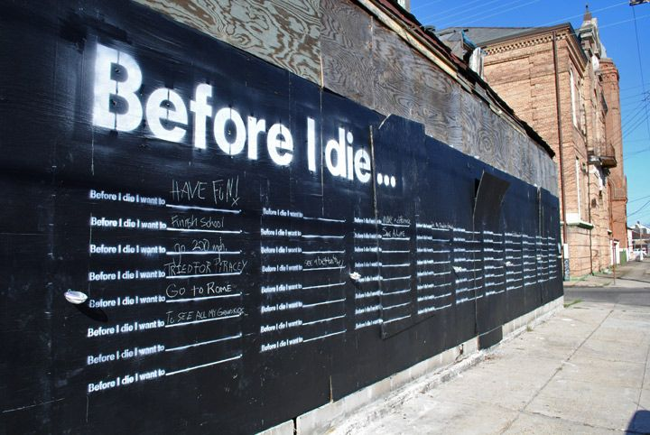 A chalkboard on an abandoned building where people can fill in what they want to do before they die--very creative! They should have these on college campuses.