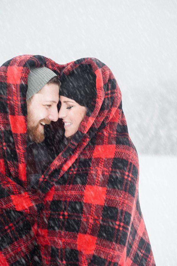 Buffalo Plaid Blanket for a Snowy Engagement | Imago Dei Photography | http://heyweddinglady.com/cozy-glam-winter-wedding-ideas/