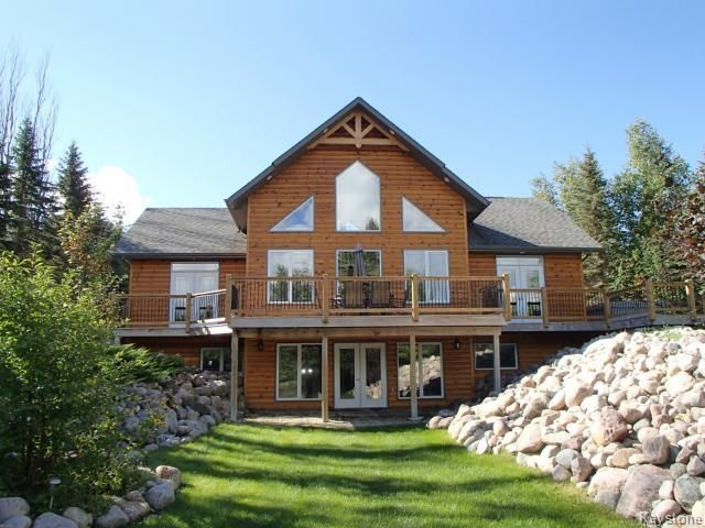 Waterfront Executive Living could be yours!  Enjoy the maintenance free exterior on this beautiful 2071 sq. ft. home overlooking Lake Lac du Bonnet.