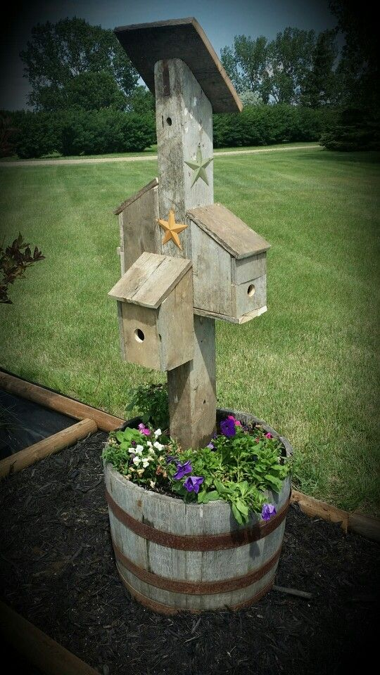 Pallet birdhouses...theres birds living in the double house facing away from camera !! Yippee