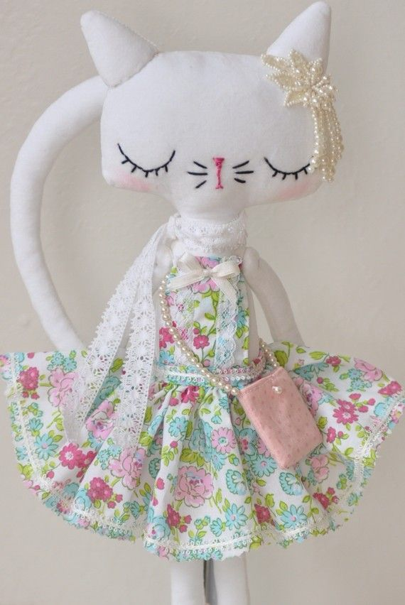 A pretty kitty for a special little girl.Made from white velvet with lots of gorgeous details including hand stitched face