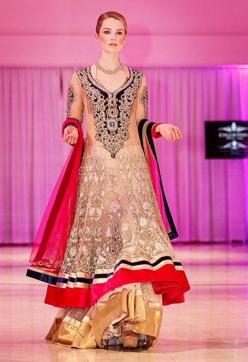 Ritu Boorgu of Charisma Design Studio gold long anarkali red black trim via IndianWeddingSite.com