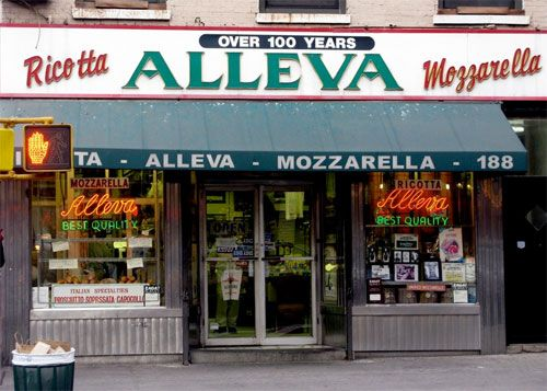 The authentic Little Italy that remains--the part that's been making and selling pretty much the same foods for one hundred years or better--is worth seeking out. In the space of one block, you can find Ferrara Bakery and Cafe (est. 1892), DiPalo Dairy (est. 1925), Piemonte Ravioli (est. 1920), and Alleva Dairy (est. 1892), the oldest Italian cheese store in the United States.: Cheese Shops, Buckets Lists, Little Italy,  Tobacconist Shops, Italy S And Feast, Italian Chee, Old Photos, Cafe Estes, Ferrara Bakeries