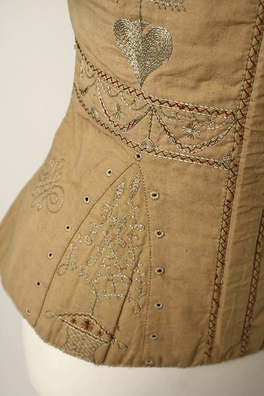 Corset  Date:     1820–39 Culture:     American Medium:     Cotton, silk Dimensions:     Length at CB: 16 in. (40.6 cm) Credit Line:     Gift of Mrs. Jerome Lauren, 2000 Accession Number:     2000.479