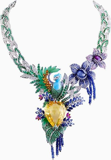 "One-of-a-kind Van Cleef & Arpels ""Splendeur Africaine"" necklace featuring a 82.68-carat pear-shaped yellow sapphire, multi-color sapphires, emeralds, diamonds, chrysoprase and turquoise set in 18K white gold!"