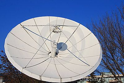 Satellite dish - large parabolic antenna outside in a sunny day.