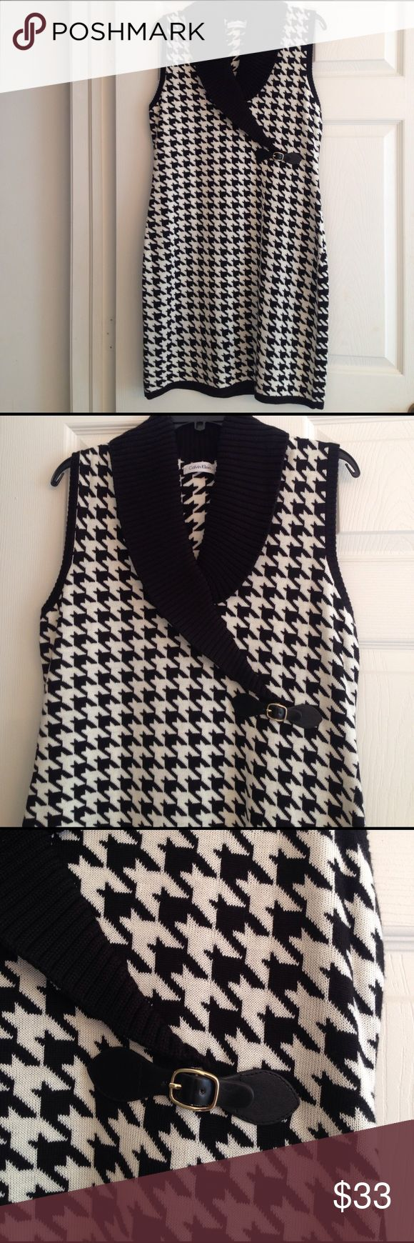 CALVIN KLEIN HOUNDSTOOTH KNIT DRESS Beautiful easy to wear dress in black and white houndstooth from Calvin Klein. Simply pullover. In excellent condition. No flaws. Calvin Klein Dresses