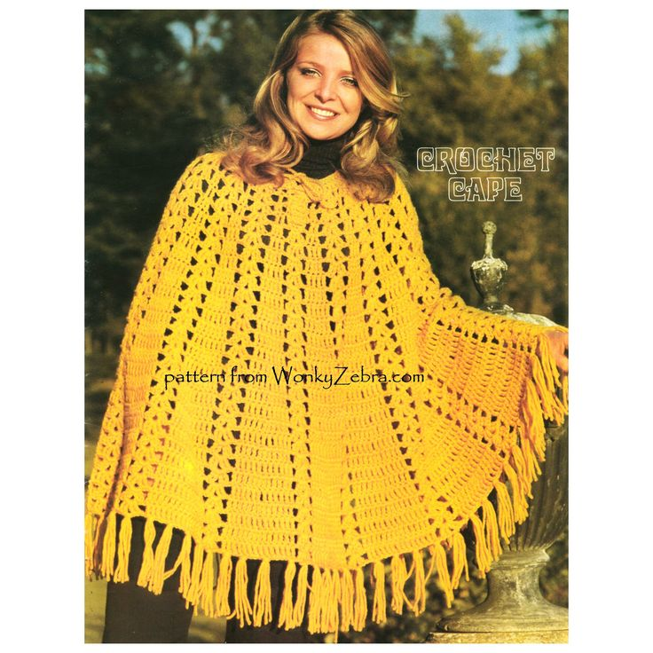 WZ932 a cape poncho tin crocheted flared panels-fab with fringes and laced neckline.
