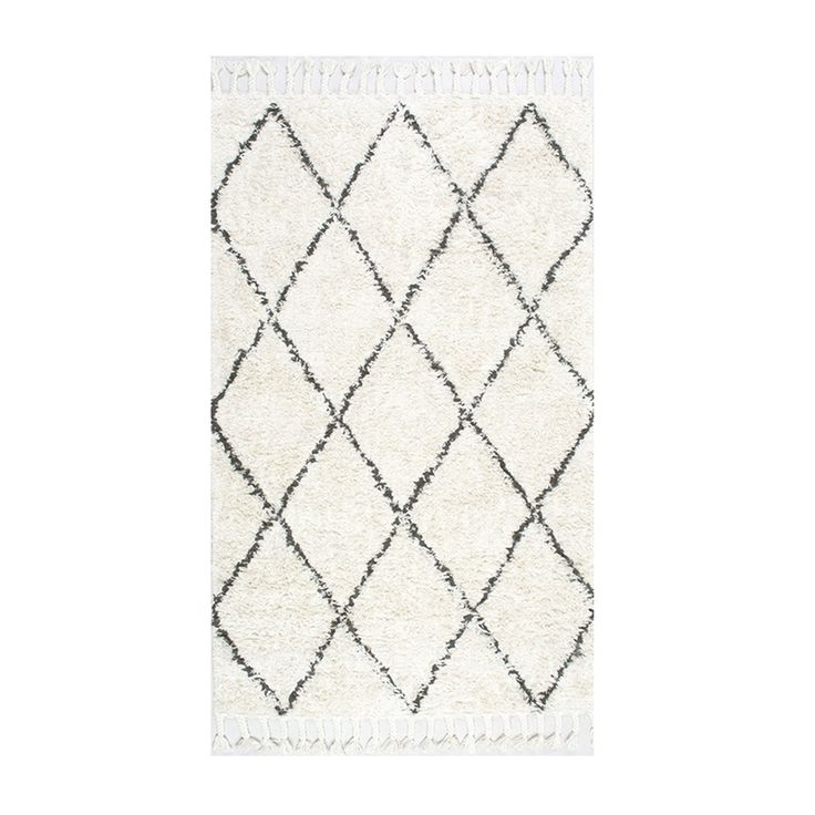 """Kate Albrecht, Mr. Kate - """"I love that you can shop the same rugs that are offered on other sites on Amazon. This Moroccan shag with tassel fringe is 100% wool, which means easy cleaning, and it's so cozy underfoot. Style it with a variety of piecesto bring in texture and a subtle pattern."""""""