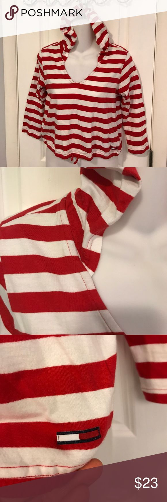 Tommy Jeans red striped hoodie top, Medium Red and white stripes are SO perfect!  This cute top has a drawstring waist, long sleeves, and a hood. You are ready for the beach or boating. Size Medium. Tommy Hilfiger Tops Tees - Short Sleeve