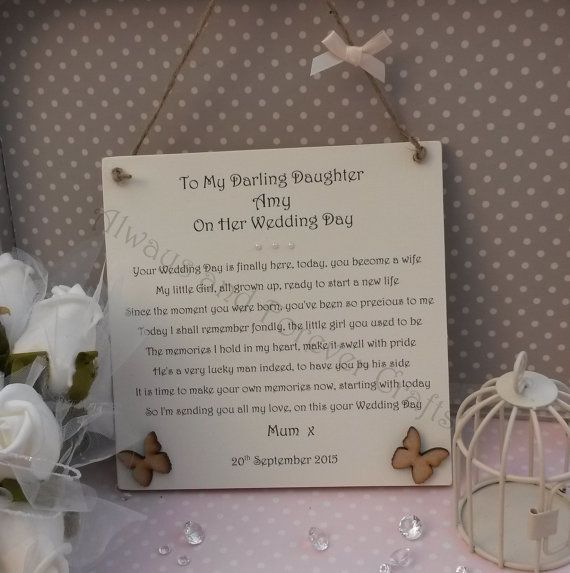 A Personalised Plaque measuring 15 x 15 cm For the Mother/Father of the Bride to give to her daughter on the day of her wedding. The details can be changed to suit your specific needs (i.e Stepdaughter, Granddaughter, Niece) Decorated with 3 small pearls and two wooden embellishments The bow on the twine can be any colour! We want our item to be personal to you. So please see our other Wedding bridal party plaques and if you see an embellishment/decoration from one of them that you would…