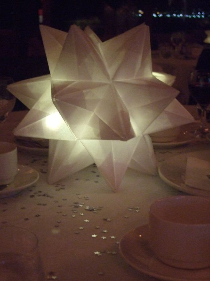 Origami Stars Made Out Of Transparent Paper Covered In