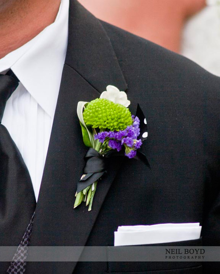 Pruple & green groom's boutonniere for purple & green wedding.  Raleigh, NC.