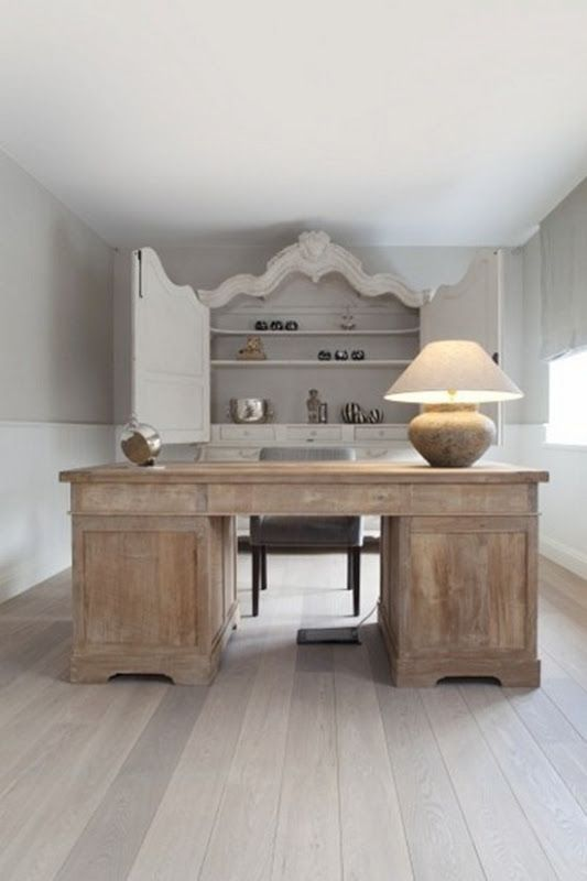 Bieke Van Houtte Bleached Oak Floors Reclaim an armoire into a cupboard to conceal your items.
