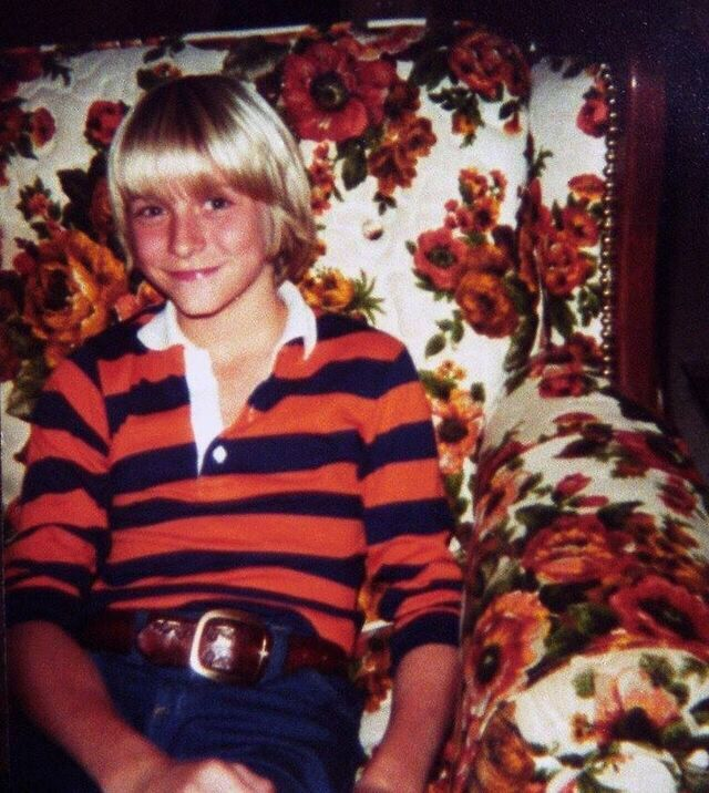 Kurt wearing a shirt similar to the iconic reed and black striped sweater he would wear later in Nirvana.  ......Dc