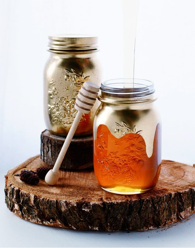 Remove the labels from glass pasta or jam jars and use them as a drinking glasses. Or, if you're feeling super luxurious, gild them.