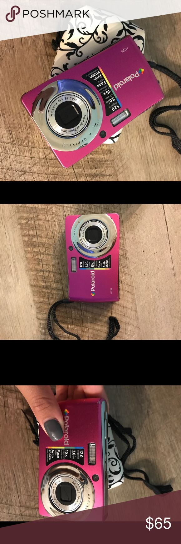 Polaroid camera hot pink 12 mega pixel, polaroid digital camera. Comes with rechargeable battery, i lost the charger port though. Also includes camera case. Some wear but works perfectly! Just don't need anymore polaroid Other