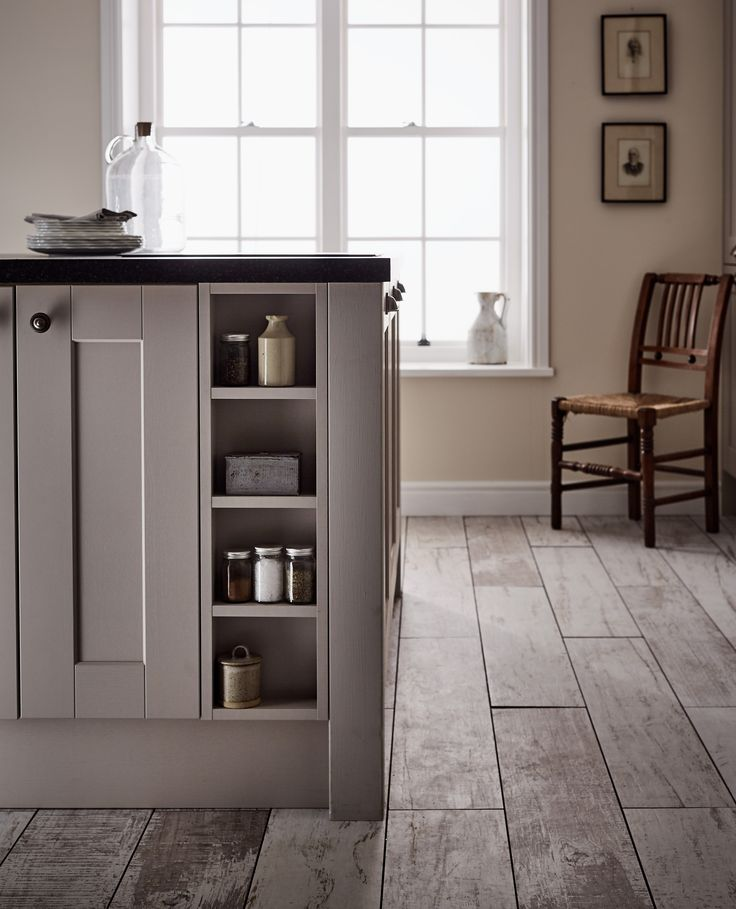 Open shelving in this kitchen island unit creates a feature piece within your Shaker kitchen.  Take a look at the Shaker Collection from Howdens. This is the Fairford Cashmere kitchen range.