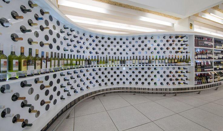 Supermarket in Athens  / KLab architecture #wine #merchandising