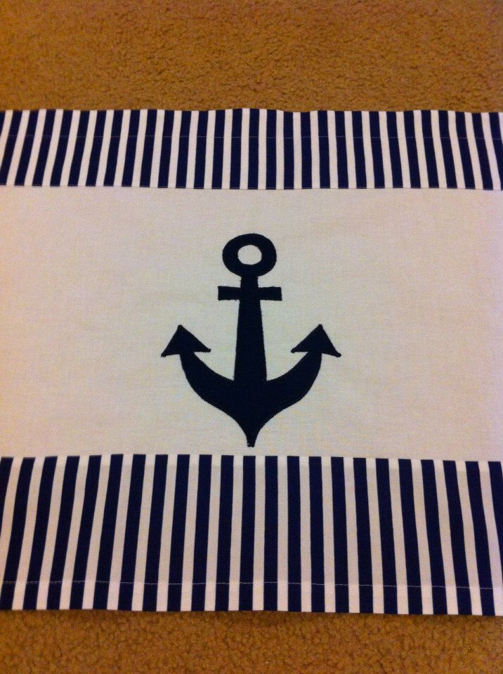 A personal favorite from my Etsy shop https://www.etsy.com/listing/152047235/anchor-valance-nautical-valance-39x17