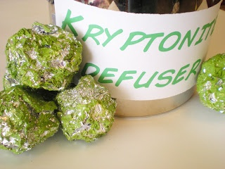 Kryptonite hunt -- paint aluminum foil balls green to be as kryptonite -- kids must gather without touching htem!