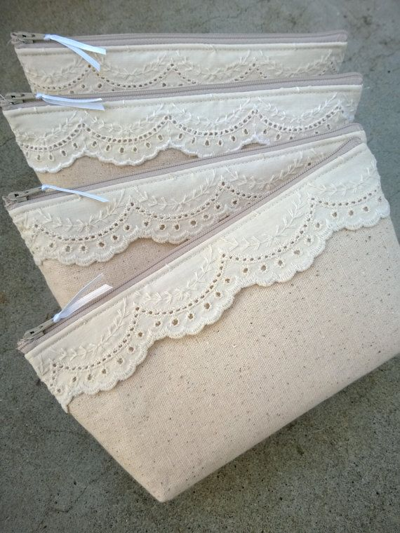 Linen Lace Bag Clutch Set --a series of lace and linen bags for bridesmaids, but this could be carried over to a set of travel bags for the bride or just some pretty feminine travel bags