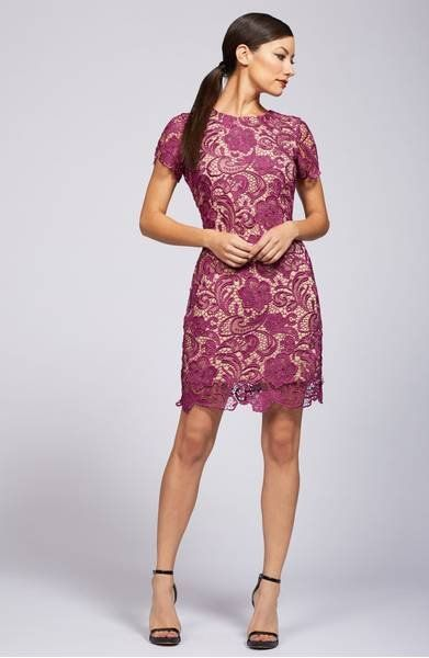 A swirling, crochet lace overlay adds understated allure to a body-skimming sheath dress.
