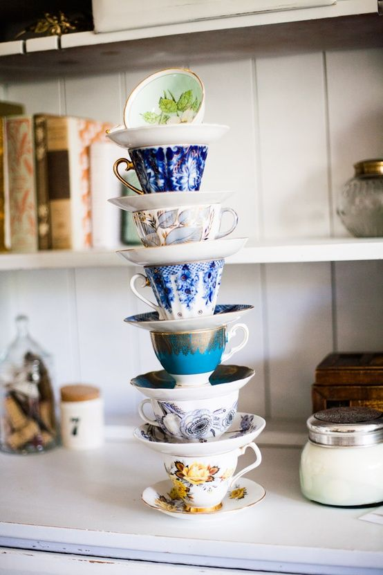 a stack of gorgeous mismatched teacups. who WOULDNT want this.