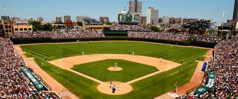 "The Friendly Confines of Wrigley Field, home of my favorite team, the Chicago Cubs.  Yes, there is someone inside the manual scoreboard, changing the numbers throughout the game.  I first went when I was just a baby.  Mom says they ""passed me around like the Cracker Jack box."""