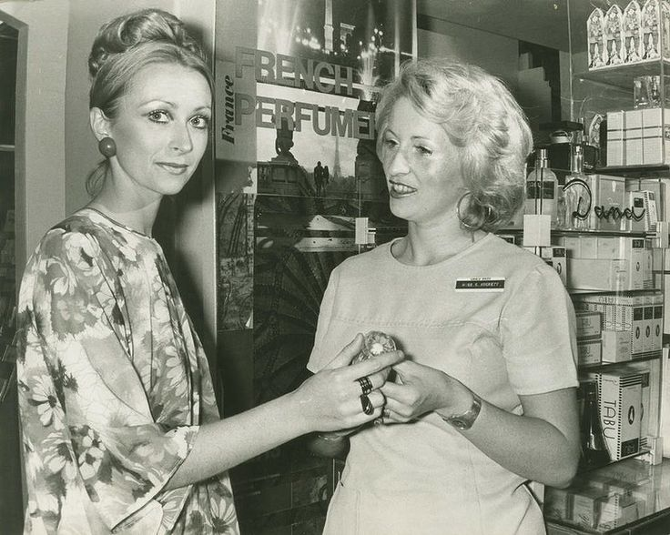 A salesgirl at Grace Brothers selling expensive French Perfume to a customer today on 19 December 1974. Photo: Kevin Berry/Fairfax Archives